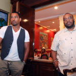 Laz Alonso & Marvin Sapp prepare to speak during the Verizon Brunch at Dooky Chase