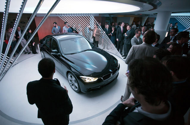 Guests look at the BMW 353i  at the new store in Paris. Photo: bloomberg.com