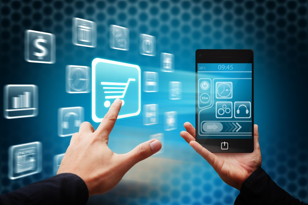 The Power of the Mobile Consumer - Smart-Hand-press-on-Cart-icon-from-mobile-phone - Divas