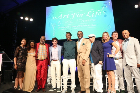 Soledad O'Brien, Tangie Murray, Danny Simmons, guest, Rashid Johnson, Tyler Perry, Walter Mosley (third from left) and Russell Simmons (R) attend the 14th Annual Art For Life Gala: A Field Of Dreams at Fairview Farms
