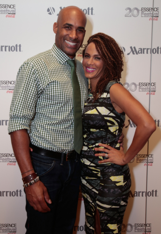 Boris Kodjoe and Nicole Ari Parker strike a pose for Totally Tripping Panel Discussion during ESSENCE Festival